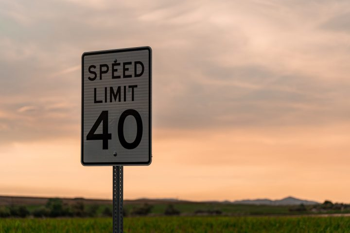 Speed limit sign showing 40 mph against a sunset sky | Speed - J. Dakar