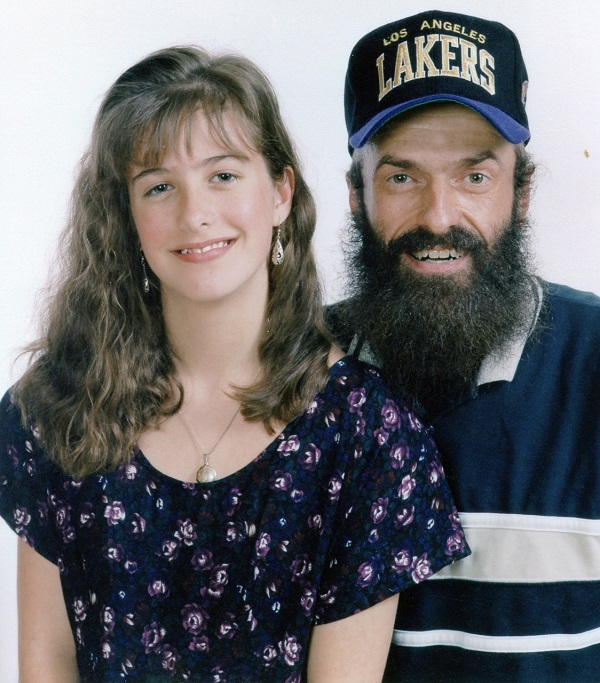 My father and me in 1993, with his signature beard and ball cap.