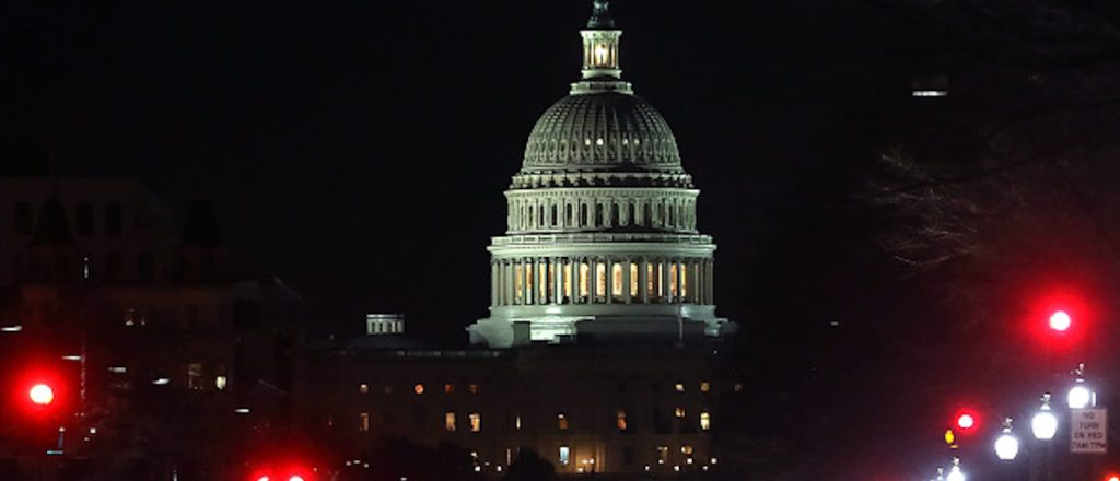 Lights shine down Pennsylvania Avenue leading to the U.S. Capitol