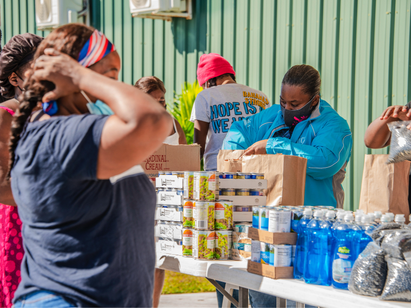 A JDC humanitarian aid workers in the Bahamas dispensing food relief to victims of Hurricane Matthew.