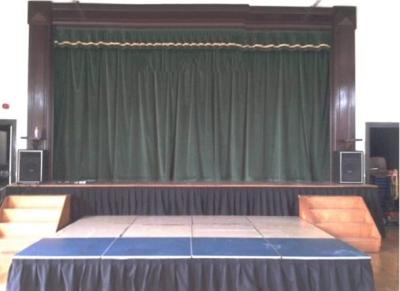 Stage with front of house curtains in Green Velvet with matching valance. Extra valance on stage edging.