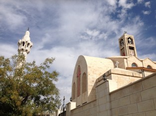 Minaret of the King Abdullah I Mosque and the Coptic Orthodox Church in the Abdali neighborhood of Amman.