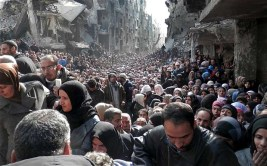 Residents of Yarmouk Camp, a Palestinian refugee camp in Damascus. After being bombarded and besieged by the Syria government, the camp is now embroiled in another round of fighting between the government, ISIS, and its own Palestinian fighters.