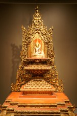 golden buddha on top of infinite detail