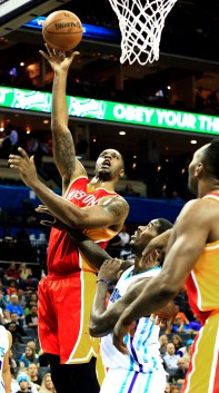 Houston Rocket's Terrence Jones, left goes for the layup against Charlotte Hornet's Marvin Williams at the Time Warner Cable Arena in Charlotte, NC on Monday April 13, 2015
