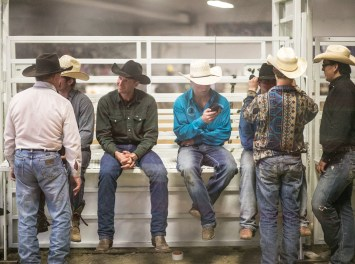 Cowboys sit and wait for the next event to start and the Devils Lake NDRA Shootout at the Burdick Arena in Devils Lake, ND on Saturday, September 24, 2016. (Joshua Komer/Grand Forks Herald)