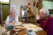 Kathryn Shablow, left, and Edna Rose enjoy each others company while eating treats and coffee at Edna's apartment in Langdon, ND. Kathryn Shablow and Edna Rose have been best friends for 95 years. Their lives have been intertwined since they were 3-and-a-half years old.