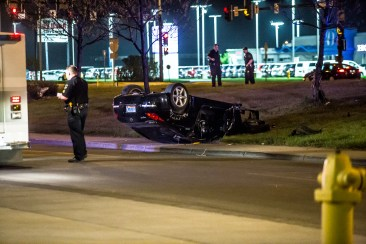 A Nissan 350z lays on it's roof after loosing control Saturday night on S. Washington and 32nd st. (Joshua Komer/Grand Forks Herald)