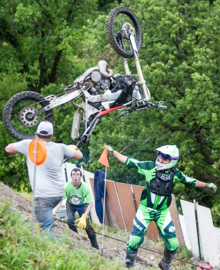 TJ Sott dismounts as his bike goes flying during his first ride at the hill climb near Fordville, ND on Saturday, July 2, 2016. (Joshua Komer/Grand Forks Herald)