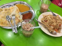 Left is the roti prata (more commonly referred to as roti canai in Malaysia) with two types of curries. The right is a rice plate with chicken. Roti prata is the popular breakfast meal here.