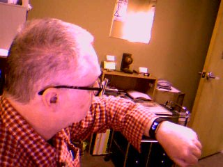 Picture of John looking at his FitBit eWatch