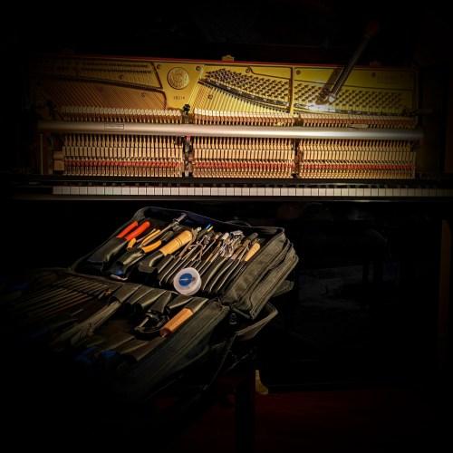 Tuning a Kawai upright piano in Ancaster, Ontario.