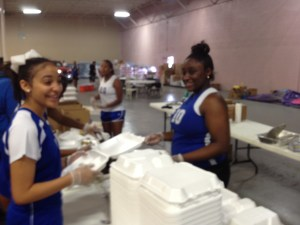 West St. John's Parish High School Volleyball Team helps their community in crisis. You can too! www.CitiIMPACT.org