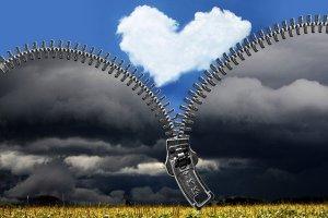 Affirmations et phrases positives - une fermeture éclair sur un paysage noir qui s'ouvre sur un ciel bleu avec un nuage en coeur