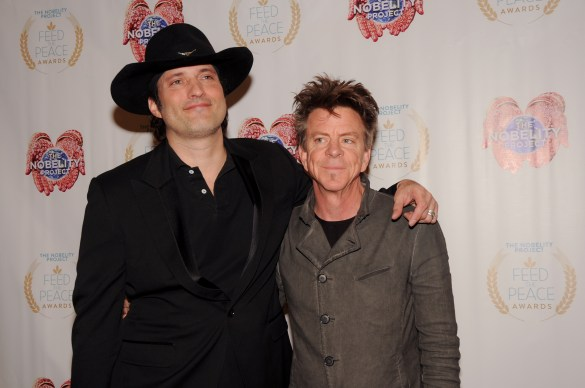 """Robert Rodriguez and Chris """"Whipper"""" Layton pose on the red carpet during the 10th Annual Nobelity Project Feed The Peace Awards at the Four Seasons Hotel on February 15, 2015 in Austin, Texas."""