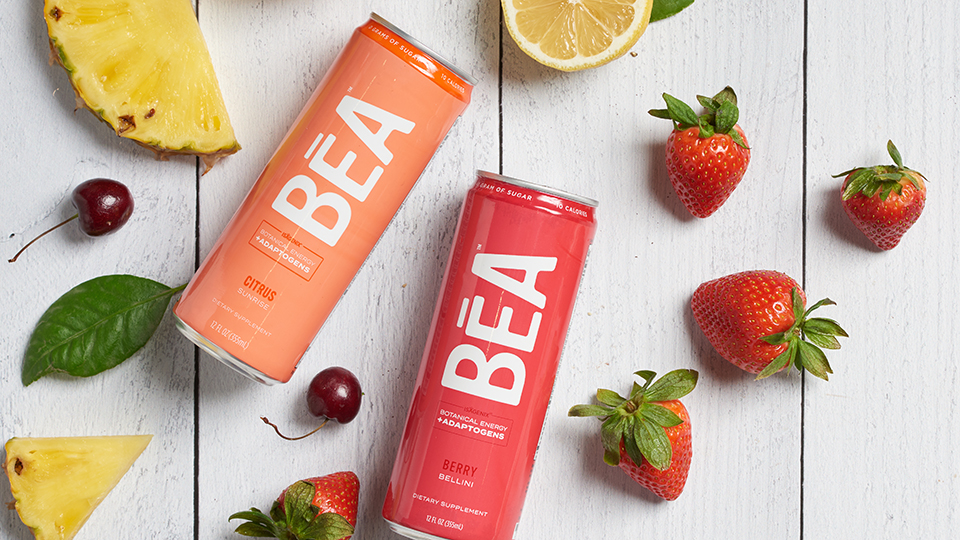 Citrus and berry BEA with fruit next to the cans.