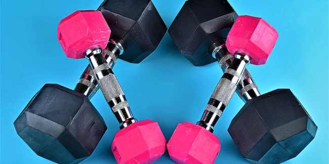 two sets of weights, one is pink the other black.