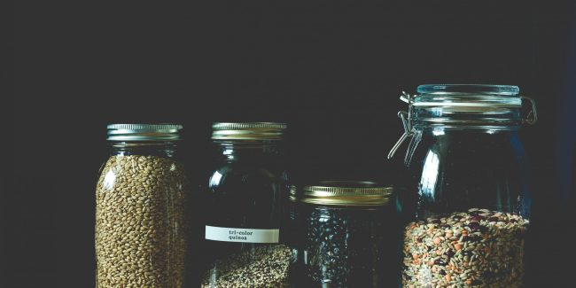 4 different sized jars with (dry) grain stored.