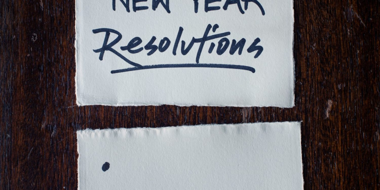 White index card with the words New Year Resolution write on in.