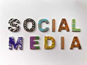 social media spelled out in different colored block letters on white background.