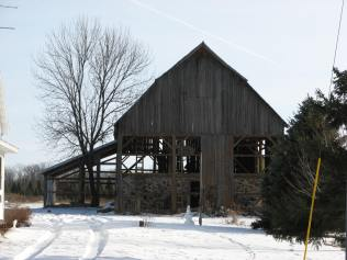 Stone foundation barn being disassembled.