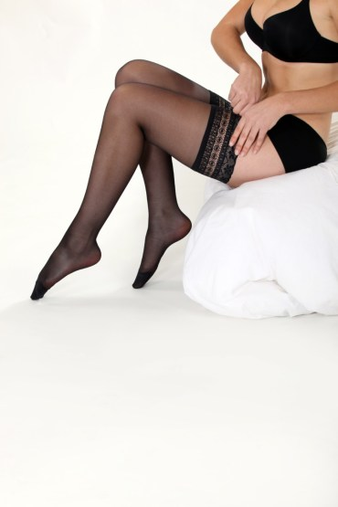 Sexy woman pulling up her stockings