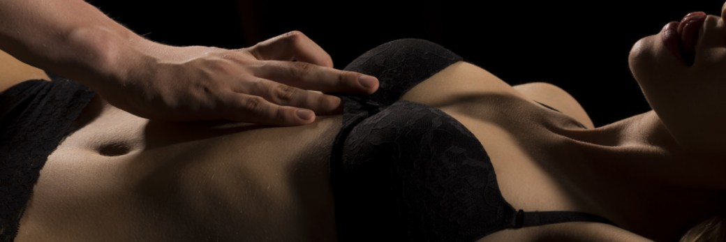 Man touching mistress in lingerie