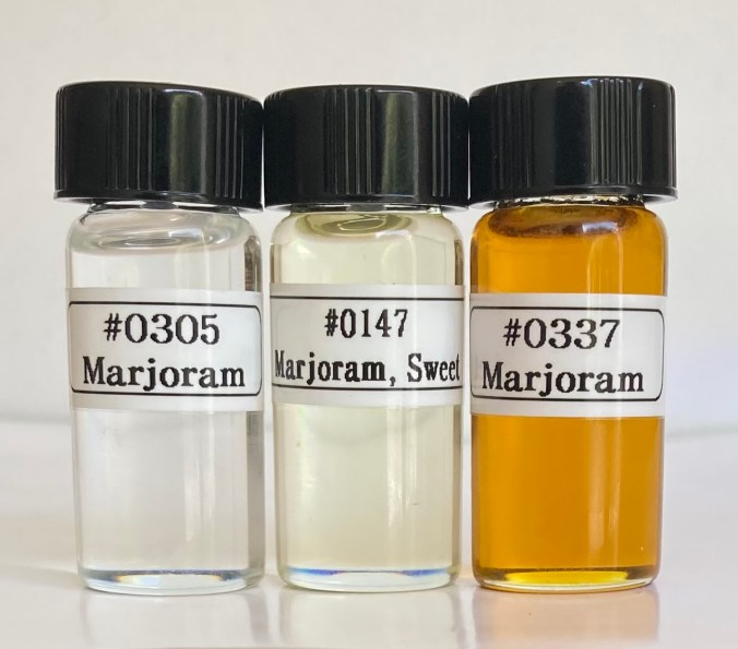 3 bottles of marjoram oil showing color and and product number