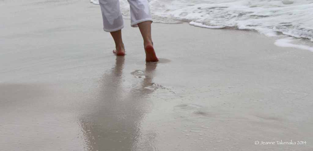 A woman's feet walking near the waves, alone. Sometimes nurturing friendships is tough because of life commitments