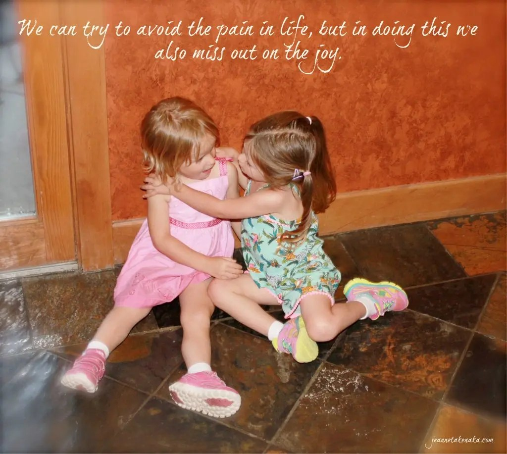 "Meme with the words, ""We can try to avoid the pain in life, but in doing this, we also miss out on the joy."" on a backdrop of two small girls playing together"