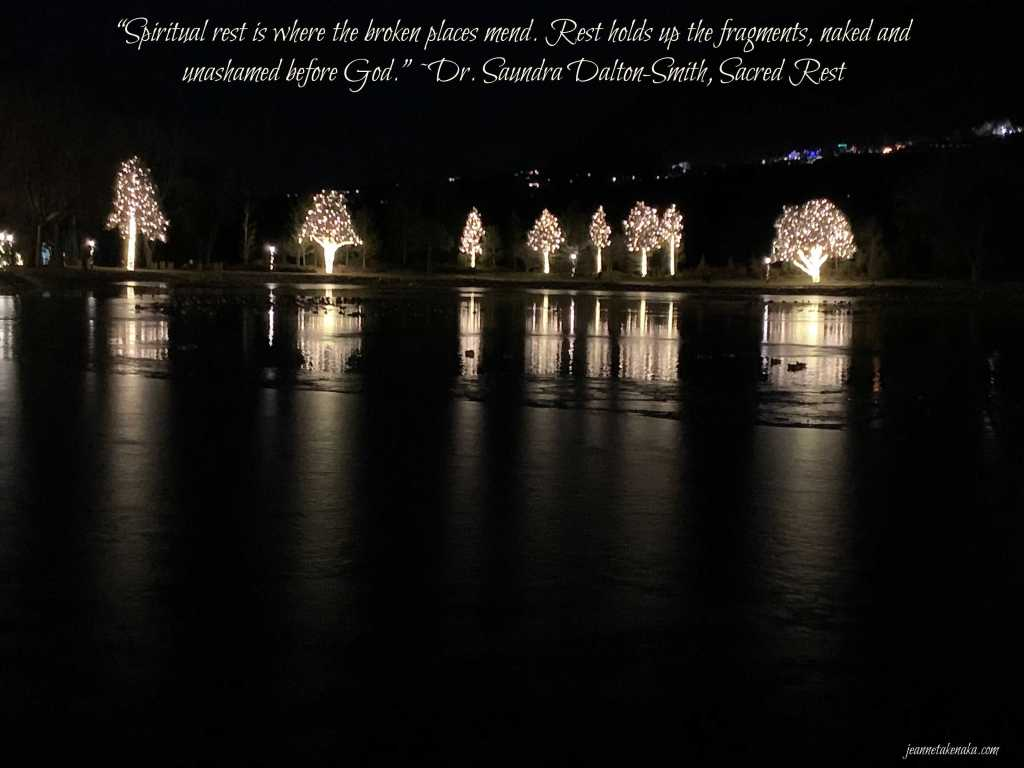 "A meme that says, ""Spiritual rest is where the broken places mend. Rest holds ups the fragments, naked and unashamed before God."" ~Dr. Saundra Dalton-Smith on a backdrop of lit up trees reflecting into a frozen pond"