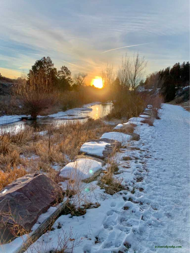 The sun rising over a creek with ice on it. Jesus' light can dispel fear's influence on our hearts and minds