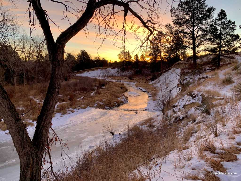 An ice-covered creek reflecting sunrise colors . . . sometimes we wait, just as we wait for the sun to rise, and our heart attitude shifts as we have an accurate perspective