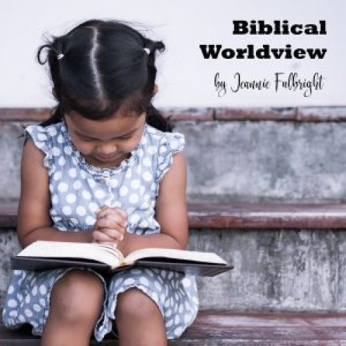 Little girl praying with open Bible