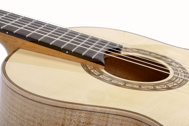 Raised fingerboard and side dots on a flamed maple classical guitar by luthier Jean Rompré