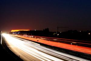 Cars speeding on highway at night