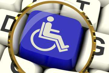 Disabled Key Magnified Showing Wheelchair Access Or Handicapped