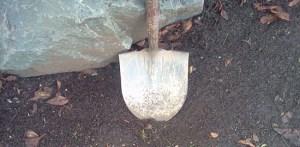 A shovel by rocks