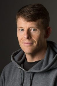 Seattle author Justin Edison at home in his hoody.