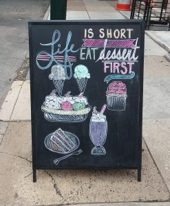 A dessert-first sandwich board outside Fezziwegs Ice Cream, Philadelphia