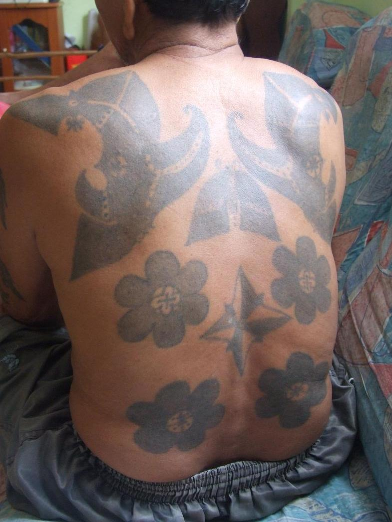 Whole back tattoos, note the compass rose, the Iban take on tattoos is quite free and newer designs often mix with traditional ones
