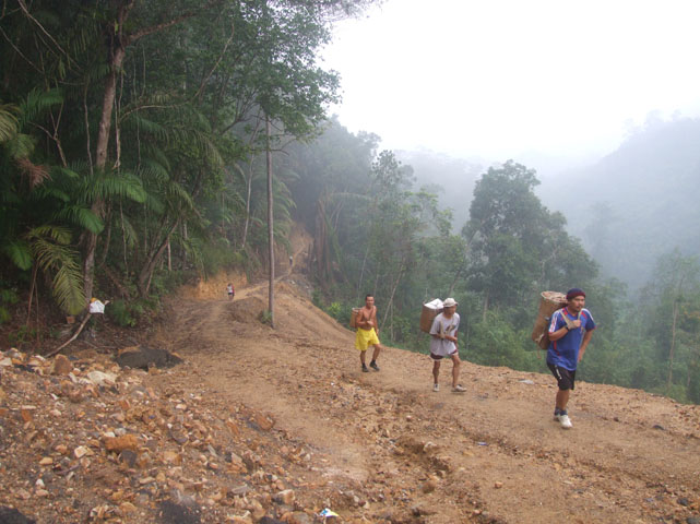 Villagers coming up from the valley to the dam construction site.