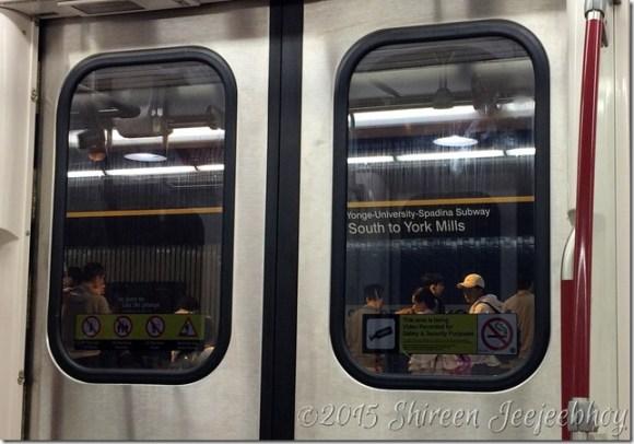 Sign Through Yonge Subway Window