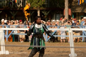 A knight with a flaming sword fighting over knights