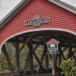 a bright red Lancaster Covered Bridge on Mechanic's road in Lancaster NH