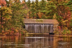 A covered bridge at Sturbridge Village in Massachusetts with fall colors
