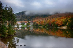 Fall foliage surrounds the Balsams Hotel and the reflection doubles the impact.