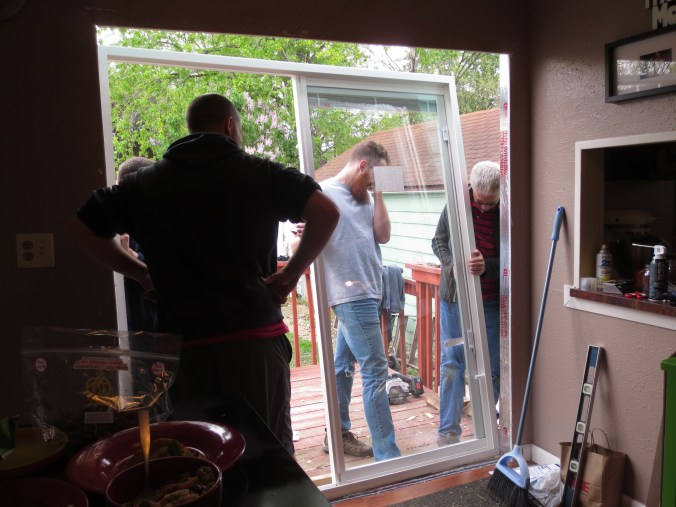 Jeff and a few guys putting in our new patio door!