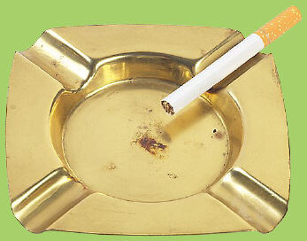 Picture of a cigarette on a dirty ashtray