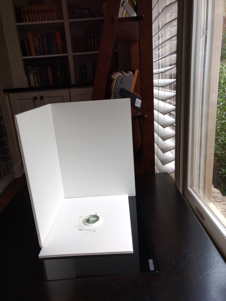 image of product arranged on white foam core boards in front of window